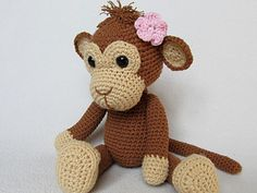 Detailed instructions and pictures help you to crochet all parts of the monkey and put them together to complete your Julie.