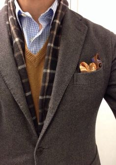 Brown wool blazer, plaid scarf, camel v neck sweater, blue gingham shirt, pocket square