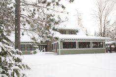 This custom home makes for an excellent winter getaway. Horizontal Cedar siding were used on the lower part of the walls and Cedar shingles above that. Notice the large screened porch facing the lake. All of this and much more make this a great vacation home in the North Woods of Wisconsin.