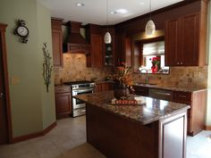 transitional kitchen light countertops | Transitional Kitchen with Cambria quartz countertops, mixed metals in ...