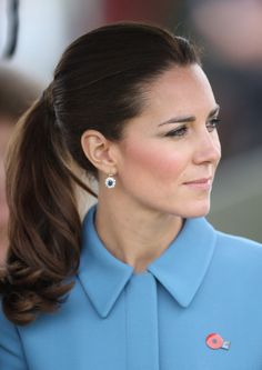 Catherine, Duchess of Cambridge wears her late mother-in-law's sapphire earrings. Diana, Princess of Wales wore them as a post earring and Catherine had them modified into a dangle style.