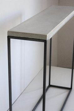 By Design _This is Handmade Minimal console/ entryway table model, despite the brutish nature of the concrete successfully displays lightness, openness and ease. Slight live edge and pours of the beautiful concrete top ads the profound character and organic feel. For Homes and Creative spaces. White&Grey, clean color combination leaves lots of opportunities to decorate your space. _______________________  Size: Lenght_85cm / 33.46in Depth_25cm /9.84in Height_ 85cm /33....