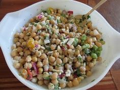 Serves8 or more  5 cups chickpeas (approximately 3 cans) 1 medium red onion, diced 1 cup cherry tomatoes (preferably sungolds), halved 5 re...