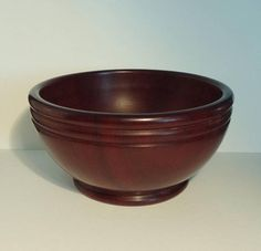 This is a very handsome example of Scottish Treen ware, very tactile, and a great potential heirloom piece. Treen means of the tree and refers to small handmade wooden household objects. This example is beautifully hand turned from a native hardwood which appears to be Walnut. Perfectly