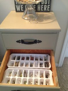 Ice cube trays to hold and organize earrings and necklaces.