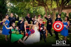 Superhero Bridal Party at Hyatt Regency Valencia by R Photography. Loving the different colored bouquets to go with the heroes!