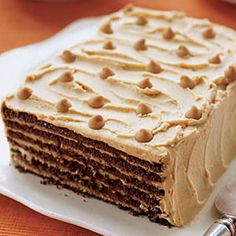 There are just 3 ingredients in this layered refrigerator cake! Chocolate cookies + peanut butter + ? #recipes