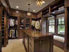 large closet with beautiful globe hanging lamp