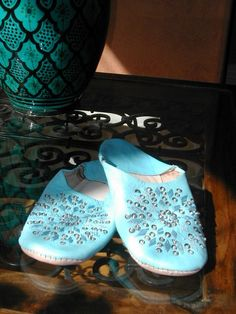 Medium pale blue leather sequinned Moroccan slippers. http://www.maroque.co.uk/showitem.aspx?id=ENT00651&p=00739&n=all