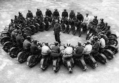 War Bikers - US Army motorcycle mounted Cavalry Scouts pull in for a briefing during training.