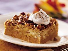 4 o'clock Dessert      1 (29 ounce) can pumpkin puree      1 (12 fluid ounce) can evaporated milk       3 eggs      1 (14oz) sweetened condensed milk **Substitute 1 cup sugar.      4 teaspoons pumpkin pie spice **I also like to put a dash of cinnamon and nutmeg      1 (18.25 ounce) package yellow cake mix      1 cup butter, melted      1 1/2 cups chopped walnuts