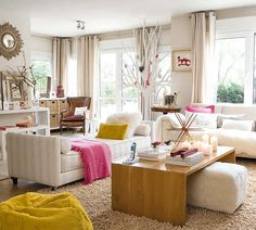 Neutral living room with pink and yellow accents. The tree in the corner is their Christmas tree! So cute!