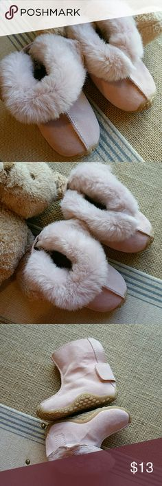 Pink fuzzy boots A really cute pair of leather suede pink fuzzy boots can be worn up or rolled down to expose the fuzzy on the back of the Hill area there's a wide band with velcro so it's really easy to get the baby's foot into and it has a slip resistant sole Circo Shoes