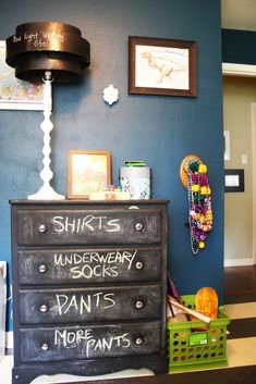 Paint dresser with chalkboard paint to add labelsTo repurpose old bureau in garage for storage...