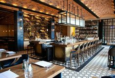 Next Wave of Hospitality Design: 25 Simply Amazing Photos | Projects | Interior Design [A chic, throwback bar at Hamilton Kitchen & Bar. Inspired by the location and historical elements of Pennsylvania, The Hamilton in Allentown, PA blends light industrial elements with a warm comforts. Photography courtesy of Celano Design Studio.]