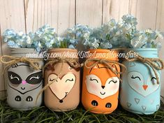 The perfect centerpiece for that woodland themed baby shower. This listing is for all 4 pint sized mason jars. The animals for this listing are a deer, raccoon, owl and fox. You can put fresh flowers, straws, napkins, cutlery, candy, pencils, etc. To see all of my cute jars,