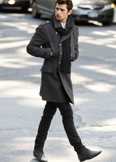 Shop this look on Lookastic:  http://lookastic.com/men/looks/trenchcoat-and-scarf-and-jeans-and-desert-boots-and-dress-shirt/346  — Charcoal Trenchcoat  — Black Scarf  — Black Jeans  — Charcoal Leather Desert Boots  — White Dress Shirt