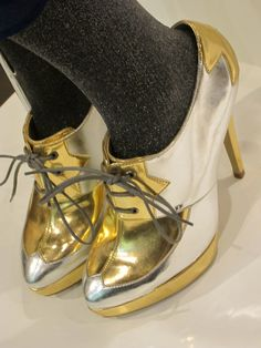 Gold oxford pumps.