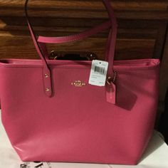 "coach tote Retails for $295/Dahlia pink canvas/ Zip closure/ Interior ( 1 zip pocket, 2 open multifunction pockets.)/ 11 3/4"" (L) x 10 1/2"" (H) x 5 1/2""(W) / 9 1/2"" handle drop. Coach Bags Totes"
