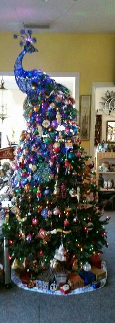 fabulous peacock christmas tree, just like cousin Debbie! Peacock Christmas Tree, Beautiful Christmas Trees, Christmas Tree Themes, Noel Christmas, Holiday Tree, Xmas Tree, Christmas Tree Decorations, Vintage Christmas, Christmas Crafts