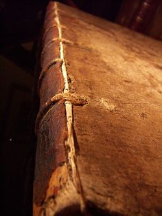 1572 and Showing its Age by philobiblon, via Flickr  spine cords - integral to the structure, not just for decoration.