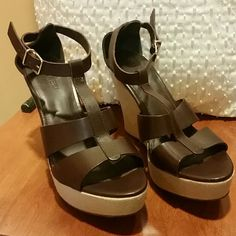 J. Crew Palma Wedge Chocolate brown leather wedge with cream color canvas. Gold buckle ankle strap, made in Italy NWOT 4 1/4 inch heel with 1 1/4 inch platform. There are a few marks on the leather but they appear as normal wear and don't detract from the beauty of the shoe. J. Crew Shoes Wedges