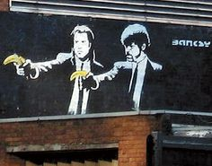 """London, 2007. In April 2007, Transport for London painted over Banksy's image of a scene from Quentin Tarantino's film Pulp Fiction, featuring Samuel L. Jackson and John Travolta clutching bananas instead of guns. Although the image was very popular, Transport for London claimed that the """"graffiti"""" created """"a general atmosphere of neglect and social decay which in turn encourages crime"""" and their staff are """"professional cleaners not professional art critics."""""""