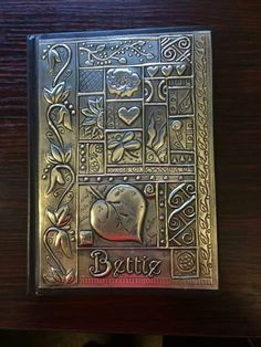 Book cover Tin Foil Art, Aluminum Foil Art, Aluminum Can Crafts, Tin Art, Metal Crafts, Embossing Stamp, Metal Embossing, Patina Metal, Pewter Metal