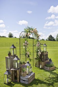wooden crates wedding ideas metal arch decorated with flowers surrounded by boxes with lanterns mark tattersall photography arch entrance 36 Rustic Wooden Crates Wedding Ideas Wedding Reception Entrance, Wedding Arch Rustic, Wedding Ceremony, Metal Wedding Arch, Wedding Arches, Backdrop Wedding, Ceremony Backdrop, Wedding Lanterns, Outdoor Wedding Decorations