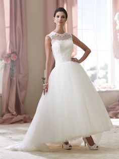 David Tutera for Mon Cheri   Style No. › 114294   Wedding Dresses 2014 Collection –Sleeveless alencon lace and tulle ballerina length A-line wedding dress features an illusion and lace jeweled neckline, lace bodice with curved natural waistline, illusion and lace back features cascading covered buttons closures, gathered full tulle skirt with sweep train. Mon Cheri Something Blue shoe Ellen style MC40020sold separately. Sizes: 0 – [...]