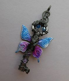 This wire wrapped key pendant has gorgeous butterfly wings with a swirling pattern colored in shimmering blues, purples and pinks edged with Steampunk Home Decor, Key Jewelry, Organza Ribbon, Key Pendant, Butterfly Wings, Door Knobs, Wire Wrapping, Locks, Purple