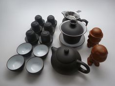 Black and white 22 piece Yixing clay tea set, includes two tea pets