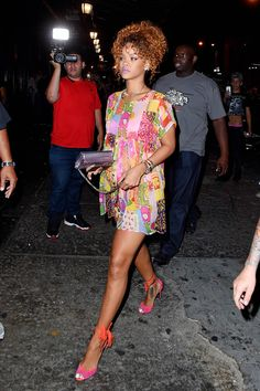 AUGUST 29, 2015 Wearing a patterned Jeremy Scott dress with matching magenta and orange heels