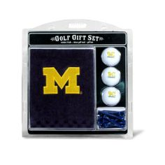 """NCAA Michigan Embroidered Team Golf Towel Gift Set by Team Golf. $19.99. Swivel clip for easy attachment and removal from golf bag. 16"""" x 22"""" tri-fold embroidered towel. Three regulation imprinted golf balls with 12 regulation golf tees.. 100% cotton towel. Checkered scrubber design. Tee off with your favorite collegiate team with this officially licensed NCAA® towel gift set from Team Golf! The set includes a 16-in x 26-in tri-fold embroidered towel, 3 golf balls, an..."""