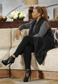 Cement Long Sleeve Top: Vince Camuto, Charcoal Gray Sweater Vest: Donna Karan NY, Legging: INC Avail at Macy's, Black Boot with Silver detail: Givenchy, Gold Earrings: Isharya, Black Watch: Bell & Ross // Queen Latifah Wardrobe Wrap-up 10.14.13
