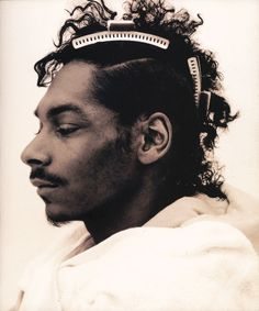 """Snoop Doggy Dogg (Jean Baptiste Mondino, 1994)  Los Angeles:  Mondino photographed Calvin Broadus the year he broke big:  His Number One debut album, Doggystyle, became the biggest-selling rap album, and his song """"Murder Was the Case"""" inspired a film of the same name directed by Dr. Dre."""