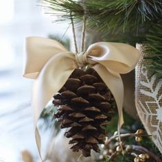 Dress up your Christmas tree with this simple, but classy pine cone with a bow ornament.