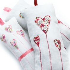 iberty print fabrics have been appliqued onto vintage linen / cotton, using freehand embroidery to ensure a unique design. Each sachet measures approx 8cm by 15cm, with a loop of ribbon on top to allow it to be hung or placed in a drawer