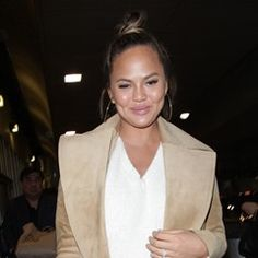 Chrissy Teigen is seen arriving at LAX Airport to catch a flight