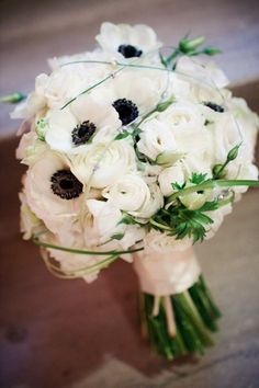 anemones mixed w/ roses and grass.