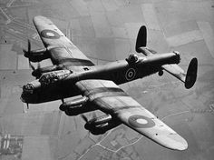 """British Bomber """"Lancaster» (Avro 683 Lancaster) No. R5689 (VN-N) of 50 Squadron Royal Air Force flying over Swinderby, England. The """"Lanc"""" first saw active service with RAF Bomber Command in 1942 and, as the strategic bombing offensive over Europe gathered momentum, it became the main heavy bomber used by the RAF, the RCAF, and squadrons from other Commonwealth and European countries serving within the RAF. The """"Lanc"""" became the most famous and most successful of WW2 night bombers."""