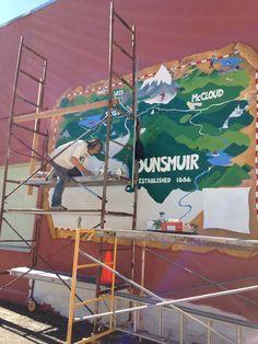"Kim working on the Dunsmuir ""Treasure Map"" mural, fall 2016."