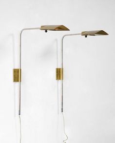 Pair of brass wall sconces. Designed by Cedric Hartman, USA, circa 1966.