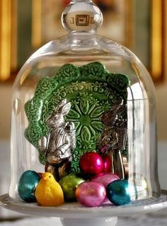 A colorful plate, a few bunny figurines, a chick and some foiled eggs create the perfect springtime vignette under this beautiful bell jar!