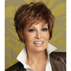 "Sparkle Wig - Ready to wear right out of the box, this short, face framing cut includes a smooth front & top that blend into short textured layeres throughout the back and sides. And it's only 2 ¼""ounces! Find this style & more @ thewigcompany.com"