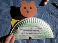 Stick puppet groundhog in paper plate