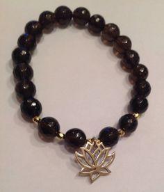 Potential  Smoky Quartz and Lotus Flower charm by InnerFireJewelry, $20.00
