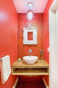 I love the idea of having an accent wall of tiles and matching the paint color.