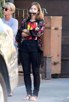Jenna dressed down for her day out wearing black skinny jeans and a floral kimono
