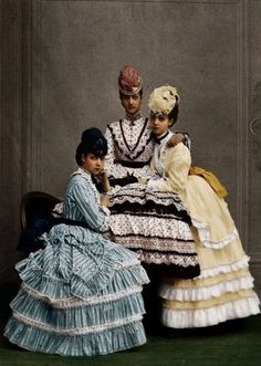 Tinted portrait of three young women, 1870s.
